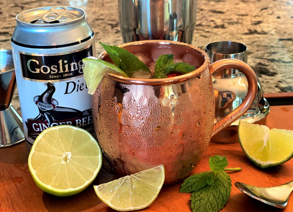 Raspberry Moscow mule with Goslings ginger beer and lime