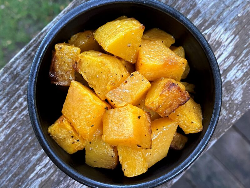 Air fried winter squash with wood background