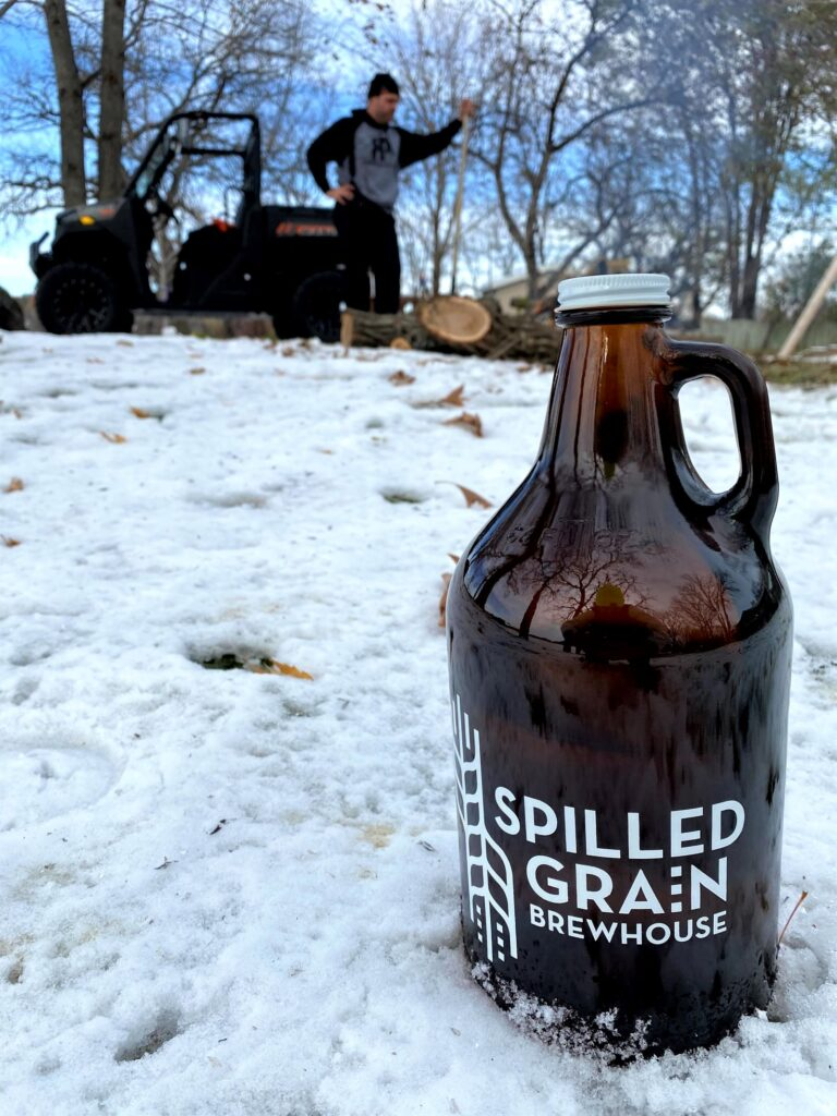 Spilled Grain Brewery Growler in snow