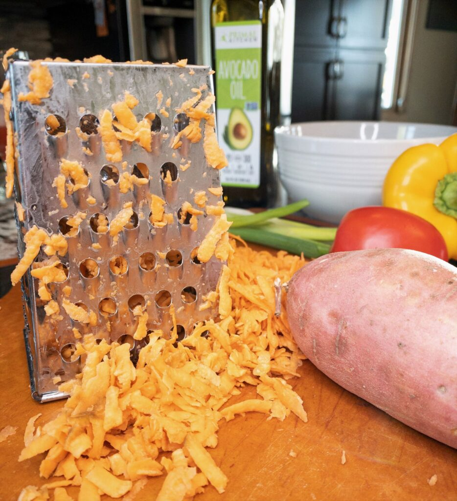 Shredded sweet potatoes with metal grater